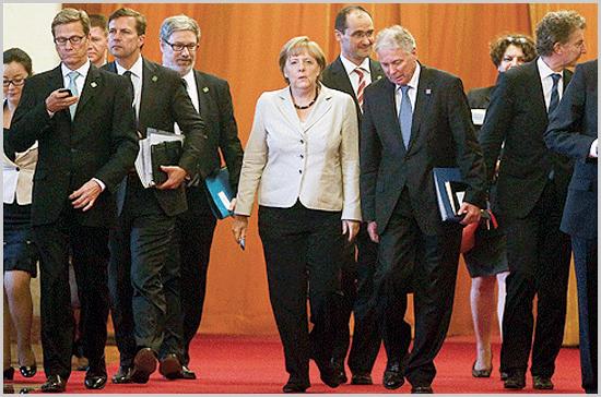 A alemã Angela Merkel aos comandos...